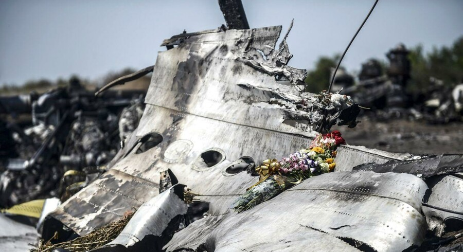 A picture taken on July 26, 2014 shows flowers left by the parents of an Australian passenger on the wreckage of the Malaysia Airlines MH17 near the village of Hrabove (Grabove) in the Donetsk region.