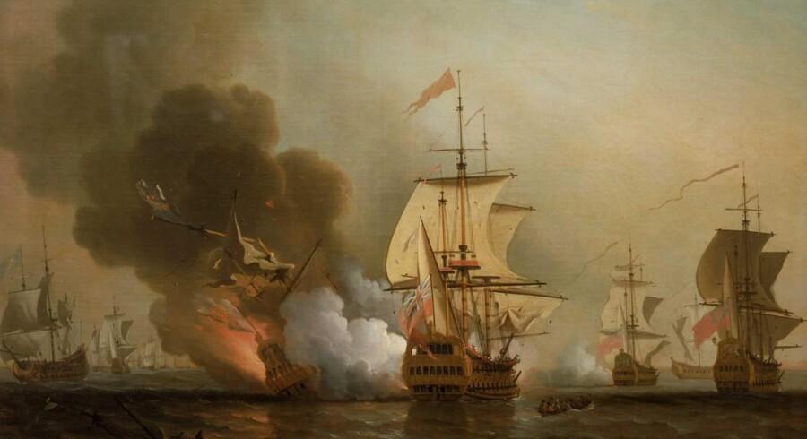 »Action off Cartagena«. Englændernes bombardement og den efterfølgende eksplosion af den spanske galeon »San José« i 1708, sådan som maleren Samuel Scott (1702-1772) forestillede sig det. Næsten 600 mennesker omkom, og guld, sølv og ædelstene for milliarder gik til bunds. Maleriet hænger i dag på National Maritime Museum i Greenwich ved London.
