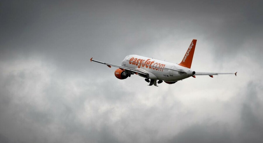 An Airbus plane of British low cost airline EasyJet takes off under heavy clouds on May 19, 2015 in Geneva. AFP PHOTO / FABRICE COFFRINI