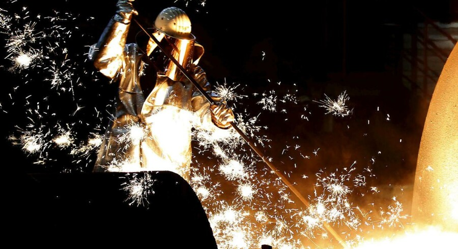 FILE PHOTO: A worker controls a tapping of a blast furnace at Europe's largest steel factory of Germany's industrial conglomerate ThyssenKrupp AG in the western German city of Duisburg in this December 6, 2012 file photo. REUTERS/Ina Fassbender/File Photo