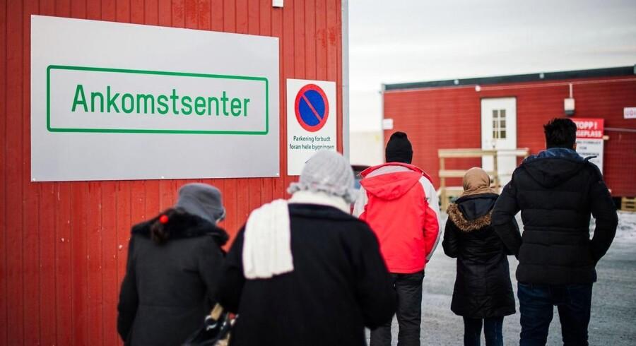 Flygtninge ved ankomstcentret i byen Kirkenes i Nordnorge tæt ved den russiske grænse, 12. november.