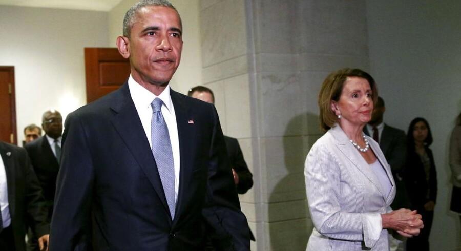 Den amerikanske præsident Barack Obama med den demokratiske minoritetsleder i Repræsentanternes Hus, Nancy Pelosi