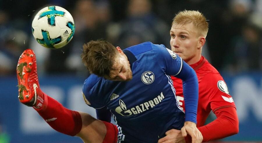 Frederik Sørensen (th.) - her i aktion i en kamp mod Schalke 04 - scorede for Köln mod Gladbach. Reuters/Wolfgang Rattay/arkiv