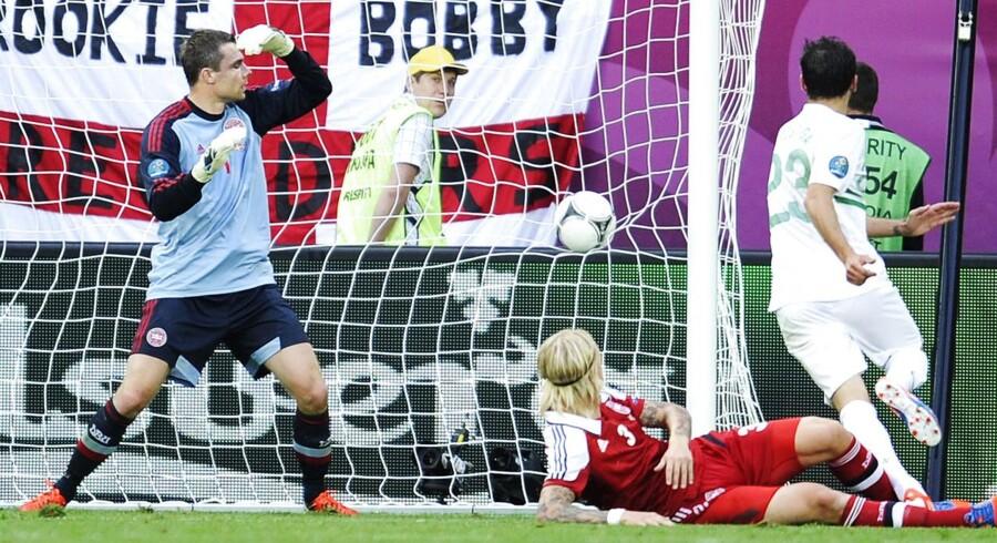 EM i fodbold 2012, Danmark - Portugal (2-3). Helder Postiga, Portugal scorer imens Stephan Andersen og Simon Kjær må se til i EM kampen onsdag d. 13 juni 2012 i Lviv. (Foto: Claus Bech/Scanpix 2012)