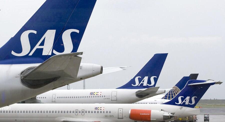 Arkivfoto. Det er alt for dyrt at lande og lette i Københavns lufthavn. Det mener SAS, der sammen med den internationale sammenslutning af luftfartsselskaber, IATA, er gået sammen om at klage til transportministeren.