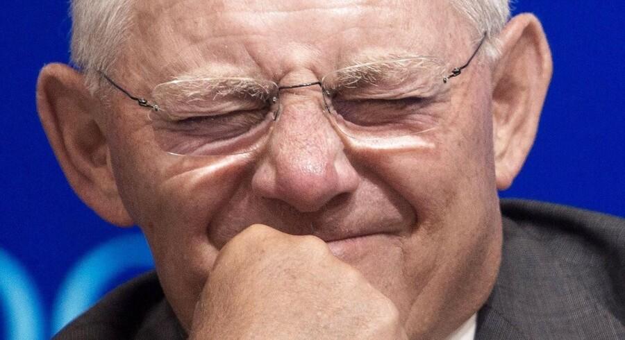 Tysklands magtfulde finansminister, Wolfgang Schäuble, har svært ved at finde en grimasse, der kan passe, når der igen bliver talt om at eftergive Grækenland noget af landets enorme gæld. Arkivfoto: Paul J. Richards/AFP