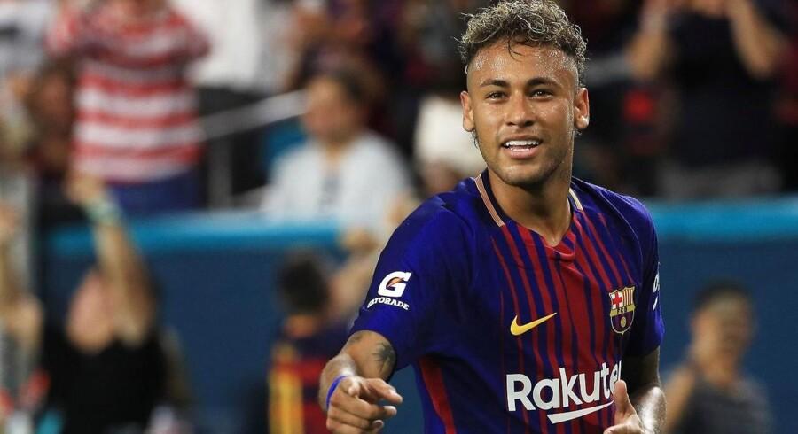 Den brasilianske fodboldspiller Neymar ønsker at skifte klub fra sin nuværende i Barcelona til Paris St. Germain. Hans frikøbsklausul bryder imidlertid alle rekorder for sit svimlende beløb 1,6 mia. kr. Arkivfoto.
