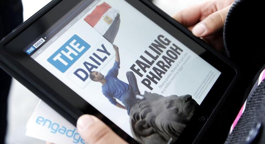 The Daily blev i februar 2011 lanceret som verdens første dagblad til Apples iPad. Arkivfoto: Stan Honda, AFP/Scanpix