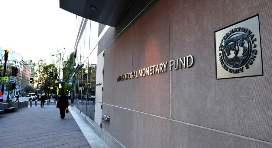 The International Monetary Fund (IMF) building sign is viewed on April 5, 2016 in Washington, DC. This year's Spring Meetings events will take place in Washington, DC, April 12-17, 2016. Thousands of government officials, journalists, civil society organizations, and participants from the academia and private sectors, gather in Washington DC for the Spring Meetings of the International Monetary Fund and the World Bank Group. / AFP PHOTO / Karen BLEIER