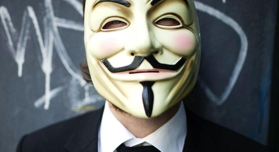 Hackergruppen Lulz Security bekender nu kulør og hævder, at de er skyld i, at CIAs hjemmeside var nede onsdag. Her ses den maskerede internetbevægelse Anonymous, som ligeledes bruger hacking som politisk redskab.