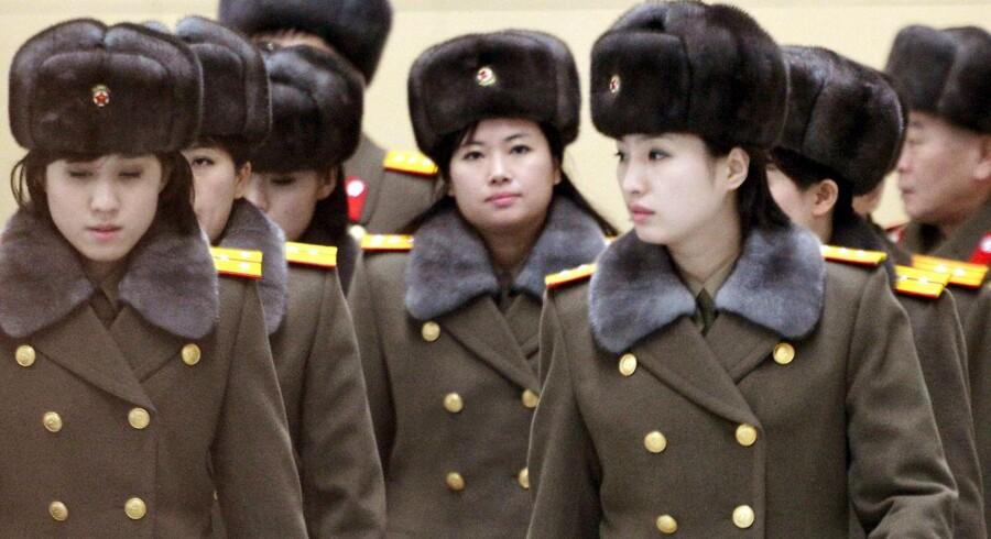 Et pigeband i traditionel forstand, er Moranbong unægteligt ikke. Medlemmerne er alle udvalgt fra de væbnede styrkers rækker - og det endda af Kim Jong-un personligt, mener nordkoreanske medier at vide.
