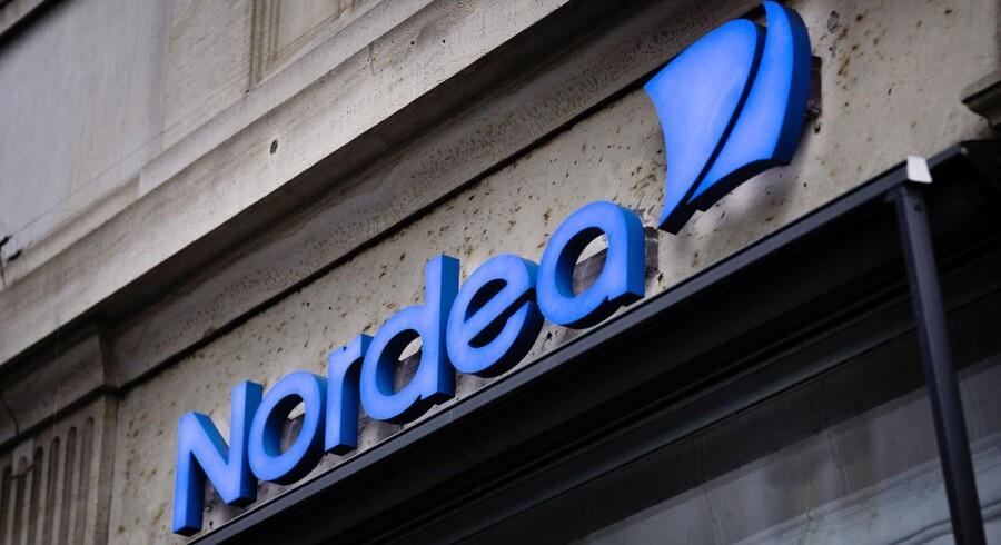 Nordens største bank kommer bedre ud af 2014 end analytikerne havde regnet med på trods af svag efterspørgsel og historisk lave renter.