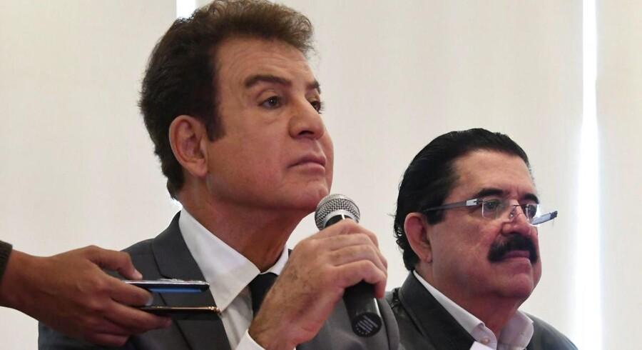 Arkivfoto. Meldingen om, at siddende præsident Juan Orlando Hernandez får fire år mere på posten, udløser nye protester.