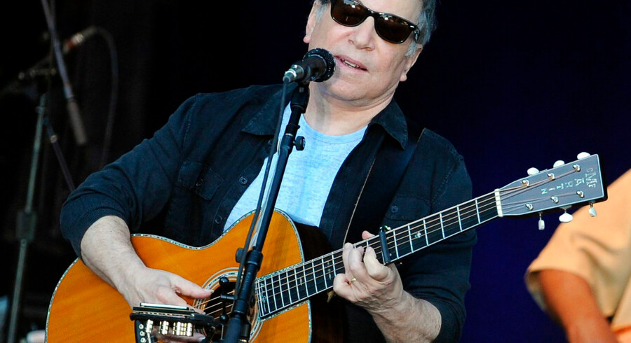 """US singer Paul Simon performs on stage in Berlin on July 11, 2011. Simon, known from the band """"Simon and Garfunkel"""", presents his latest album """"So Beautiful or So What"""". AFP PHOTO / BRITTA PEDERSEN GERMANY OUT"""