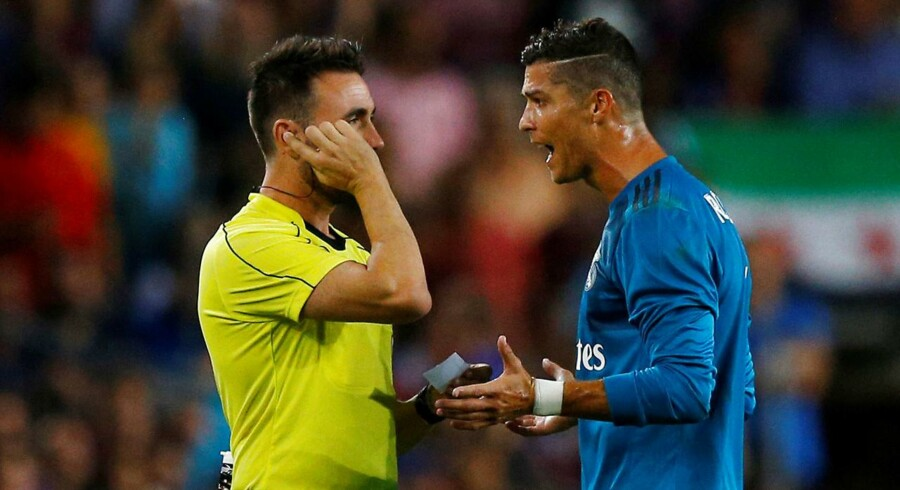 Soccer Football - Barcelona v Real Madrid Spanish Super Cup First Leg - Barcelona, Spain - August 13, 2017 Real Madrid's Cristiano Ronaldo speaks with referee Ricardo de Burgos Bengoetxea after being shown a red card after receiving a second yellow card for simulation REUTERS/Juan Medina
