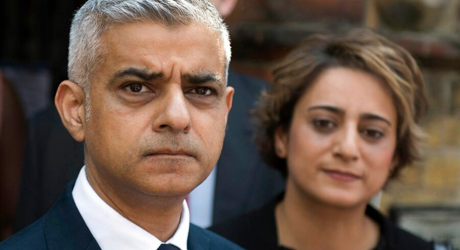 epaselect epa06035201 London Mayor Sadiq Khan and wife Saadiya Khan (R) leave St.Clements Church after a service in honour of those affected by the Grenfell Tower Fire in North Kensington, London, Britain, 18 June 2017. Search and Rescue efforts are continuing to sift through the burnt out remains of the tower. At least 58 people are now missing and presumed dead in the Grenfell Tower disaster, police have said. This latest figure includes the 30 already confirmed to have died in the fire. The cause of the fire is yet not known. EPA/WILL OLIVER