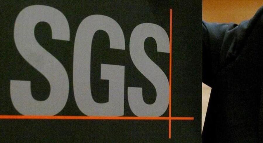 Det schweiziske firma SGS må æde en nedjustering i kølvandet på den schweiziske centralbanks beslutning om ikke længere at forsvare schweizerfrancens valutaloft over for euroen.