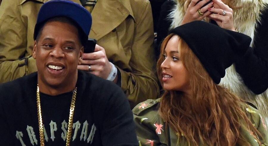 Jay-Z med konen Beyonce Knowles-Carter, som også er med i Tidal sammen med en lang række af andre superstjerner. AFP Photo/Timothy A. Clary/Scanpix.