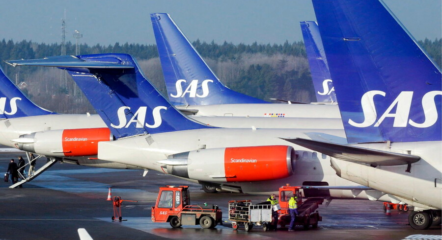 epa05201456 (FILE) A file photo dated 03 February 2009 showing Scandinavian airline SAS MD-80 and Boeing 737 aircrafts parked at the gates at terminal 4 at Arlanda Airport north of Stockholm, Sweden. Scandinavian airline SAS on 08 March 2016 reported a first quarter net loss of 246 million kronor (29 million dollars), but said it more than halved its losses compared to a year ago. Cost-cutting measures and lower fuel costs helped stem the flow of red ink. A year ago, the net loss totalled 640 million kronor. Revenue in the November 2015 to January 2016 period was 8.27 billion kronor, down from 8.3 billion kronor a year ago. The first quarter is traditionally its weakest. The airline - whose main owners are the governments of Denmark, Norway and Sweden - is facing stiff competition from low-cost carriers such as Norwegian Air Shuttle. EPA/JOHAN NILSSON SWEDEN OUT