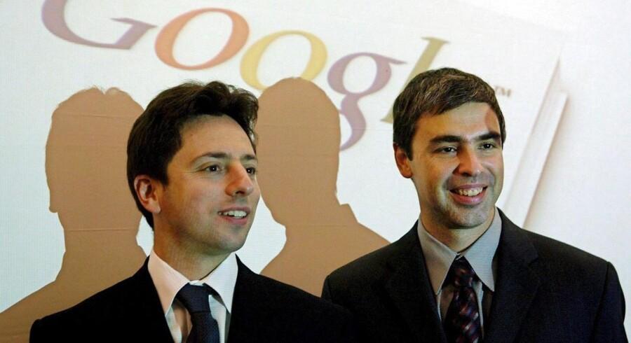 Google-stifterne Larry Page (TV.) og Sergey Brin (TH.) havde mildest talt en god fredag.