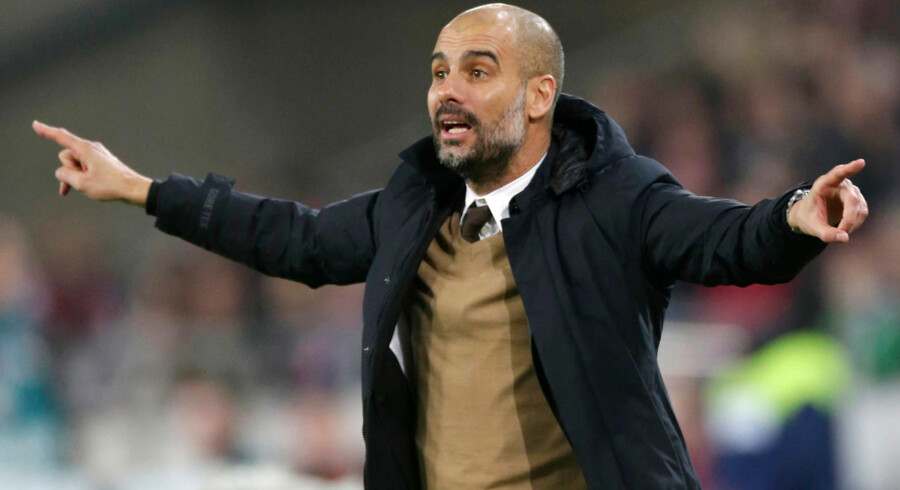 Bayern Munich's manager Pep Guardiola gestures during his team's match against Hanover 96 at the HDI Arena, Hanover, Germany, December 5, 2015. Pep Guardiola has signed a three-year contract to take over as Manchester City manager in July, the Premier League club said on Monday. REUTERS/Fabian Bimmer DFL RULES TO LIMIT THE ONLINE USAGE DURING MATCH TIME TO 15 PICTURES PER GAME. IMAGE SEQUENCES TO SIMULATE VIDEO IS NOT ALLOWED AT ANY TIME. FOR FURTHER QUERIES PLEASE CONTACT DFL DIRECTLY AT + 49 69 650050. - RTX1ZE3K