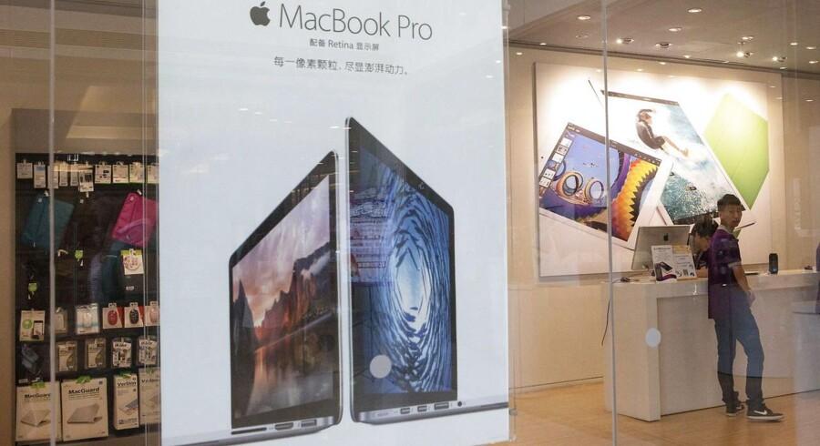 Apples Macbook Pro er nu et af de Apple-produkter, som de kinesiske myndigheder har forbudt offentlige indkøb af. Foto: Rolex dela Pena, EPA/Scanpix