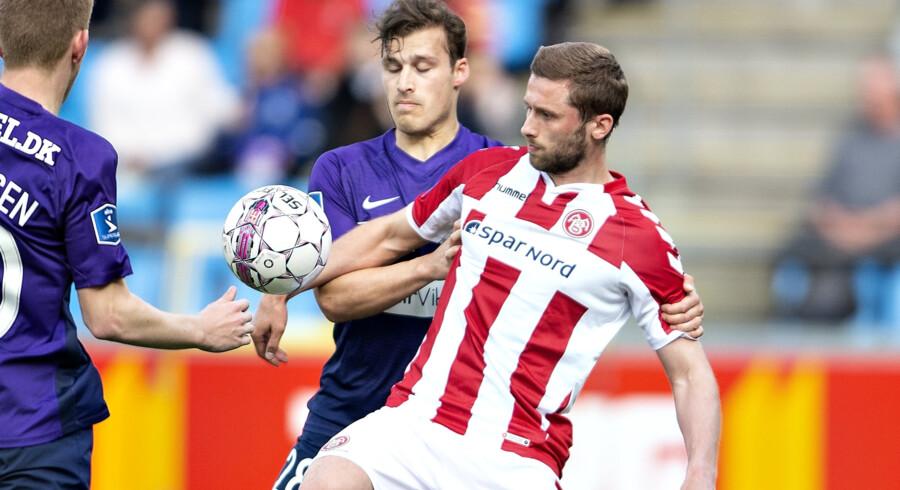 AaB og FC Midtjylland spillede 3-3 i Aalborg i et intenst opgør, hvor midtjyderne fik udlignet kort før tid. Scanpix/Henning Bagger
