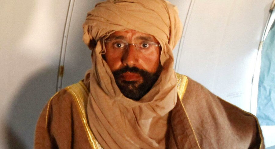 Saif al-Islam gav sig ud for at være kameldriver, da han lørdag blev fanget af oprørere på vej til Niger.
