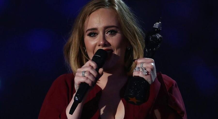 Sangerinden Adele er netop blevet kåret til at være Englands rigeste musiker under 30 år, efter udgivelsen af det populære album. (AFP / JUSTIN TALLIS)