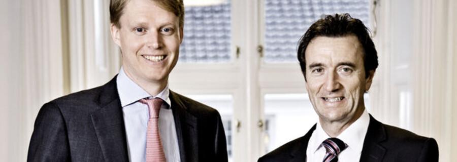 Ifølge bestyrelsesformand i TDC Vagn Sørensen (th) vil den nye direktør Henrik Poulsen (tv) være bedre til at føre strukturreformen i virksomheden videre.