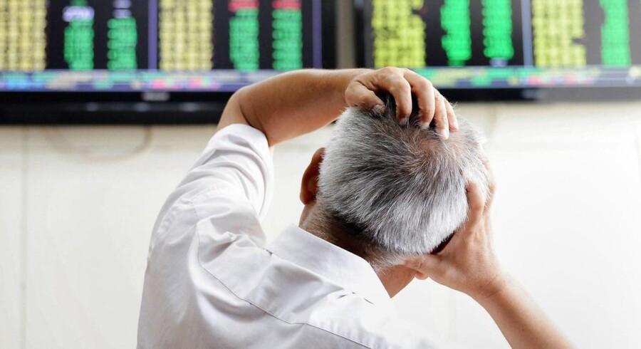 Arkivfoto. En overvejende negativ stemning præger fredag de asiatiske aktiebørser, efter at det amerikanske marked torsdag dykkede for ottende børsdag på stribe.
