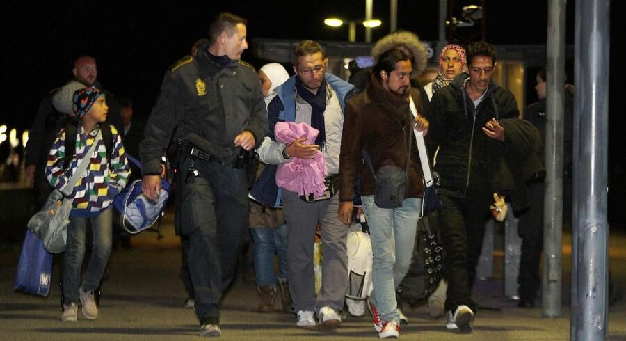 Flygtninge ankommer til Rødby fra Tyskland.