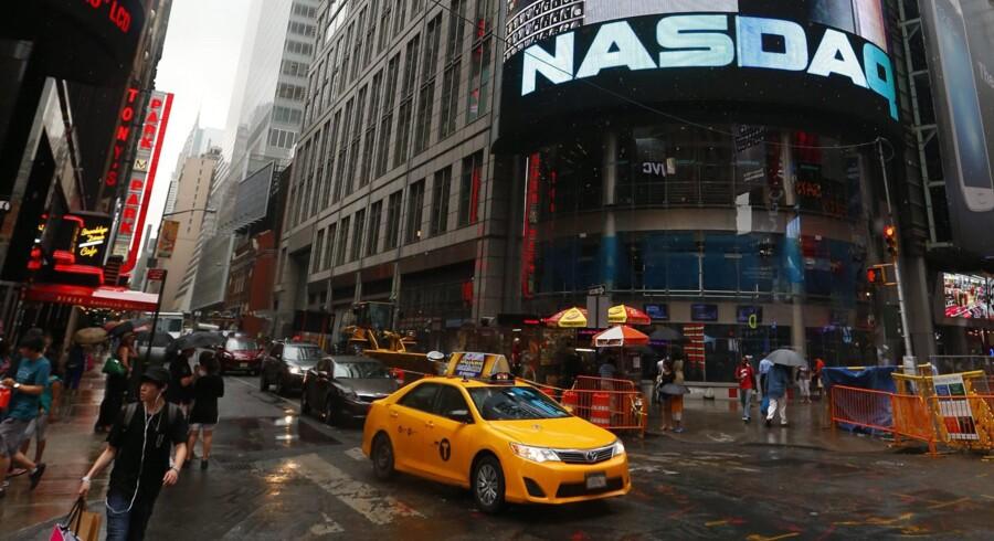 Leg med en halv million fiktive kroner i Berlingske Business' aktiespil og vind en rejse til New York med besøg hos Nasdaq-børsen på Times Square. Foto: Jason Szenes /EPA.