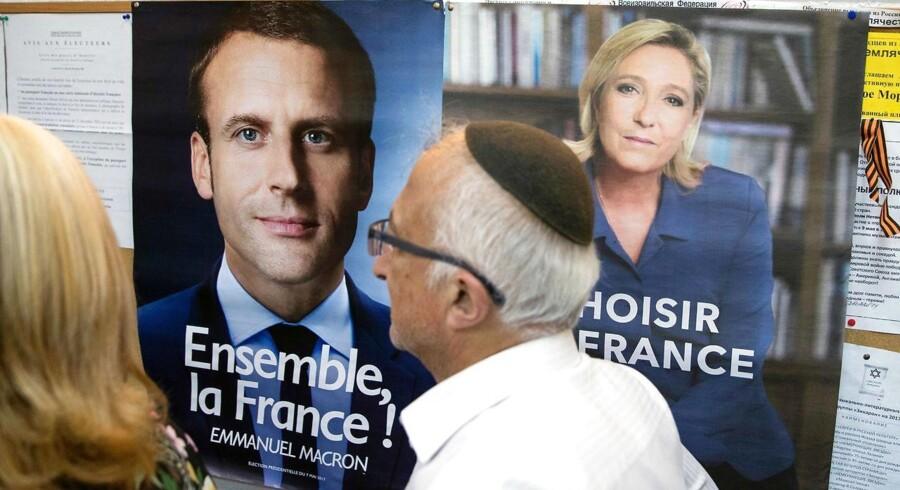 Macron står i meningsmålingerne til at vinde søndagens anden og afgørende valgrunde med omkring 60 procent mod 40 procent til Le Pen. / AFP PHOTO / JACK GUEZ