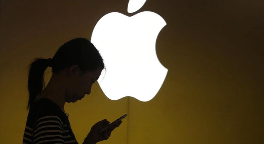 Størstedelen af kineserne kan fortsat ikke købe Apple-telefoner gennem deres mobilselskab, fordi Apple efter flere års forhandlinger stadig ikke har en aftale med China Mobile, der er verdens største mobilselskab. Foto: Aly Song, Reuters/Scanpix