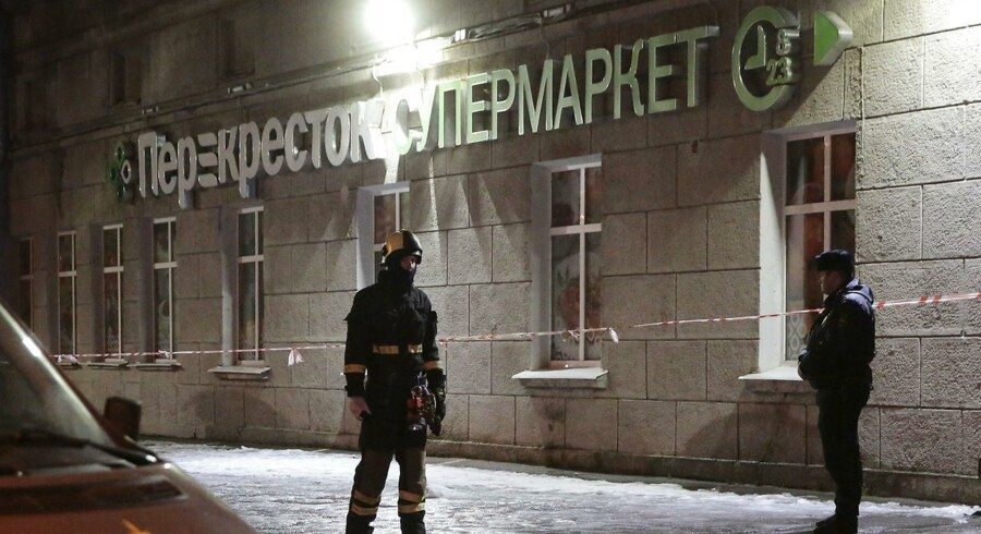 An Emergency Ministry member and a policeman are seen outside a supermarket after an explosion in St Petersburg, Russia December 27, 2017. REUTERS/Anton Vaganov