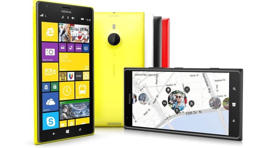 Husker du dem - de gamle Windows-telefoner? Nokia satsede hele forretningen på sammen med Microsoft at forsøge at bryde Googles og Apples dominans på mobilområdet. De tabte. Her er Nokias Lumia 1520-smartphone i karakteristisk gult (som blev udsolgt, fordi det altid var den farve, der blev annonceret med) og med en skærm på seks tommer, anno 2013. Arkivfoto: Nokia/EPA/Scanpix