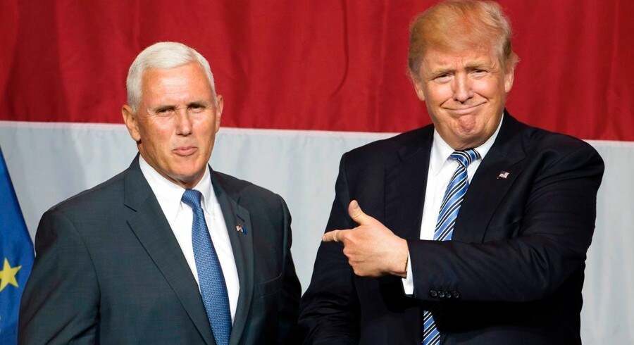 (FILES) This file photo taken on July 12, 2016 shows US Republican presidential candidate Donald Trump (R) and Indiana Governor Mike Pence (L) taking the stage during a campaign rally at Grant Park Event Center in Westfield, Indiana. Trump named Pence as his vice presidential running mate, on July 15, 2016. / AFP PHOTO / Tasos KATOPODIS