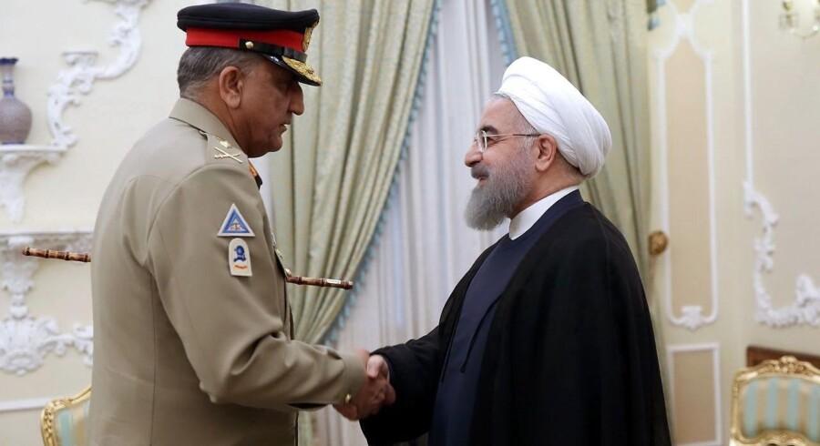 Irans præsident, Hassan Rouhani (th.), erklærer ifølge Reuters, at Islamisk Stat er besejret.