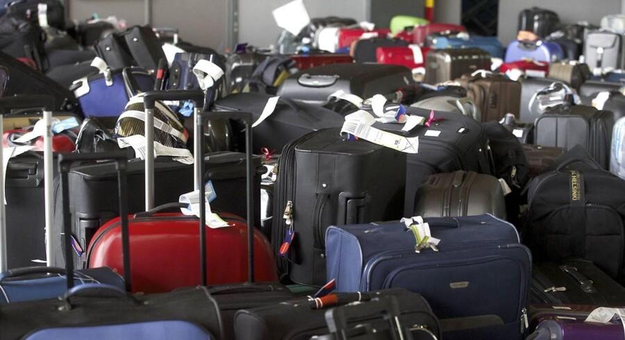 Ny bagage-løsning skal gøre det nemmere for medarbejdere, bedre for kufferterne og hurtigere at tømme fly. AFP PHOTO / BELGA PHOTO NICOLAS MAETERLINCK