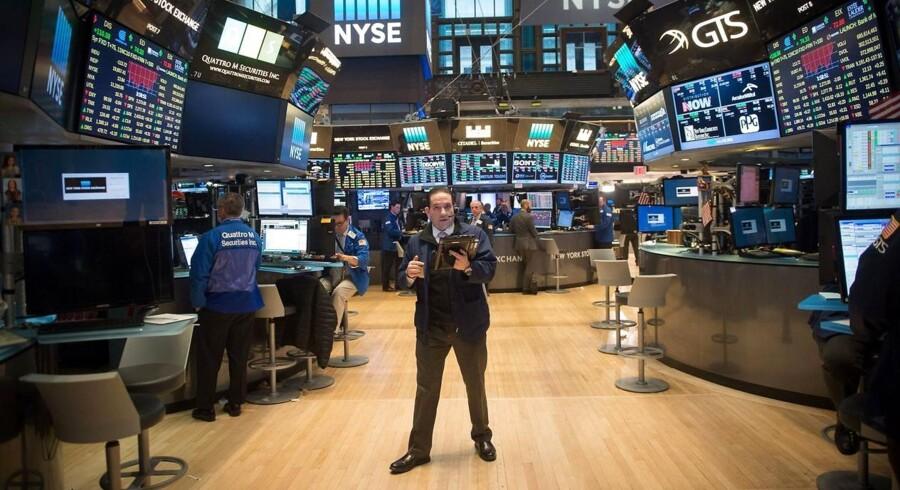 Arkivfoto. De amerikanske aktier lukkede med pæne stigninger fredag, hvor en solid jobrapport var med til at øge optimismen, mens bankerne fik stærk medvind fra politisk hold, da signalerne fra Det Hvide Hus indikerer et opgør med de restriktioner, branchen er underlagt efter finanskrisen.