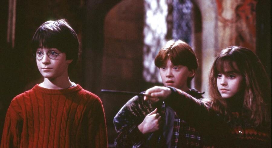 Trekløveren Harry Potter, Hermione Granger og Ron Weasley blev igennem de otte film spillet af Daniel Radcliffe, Emma Watson og Rupert Grint. Foto: Reuters/Peter Mountain