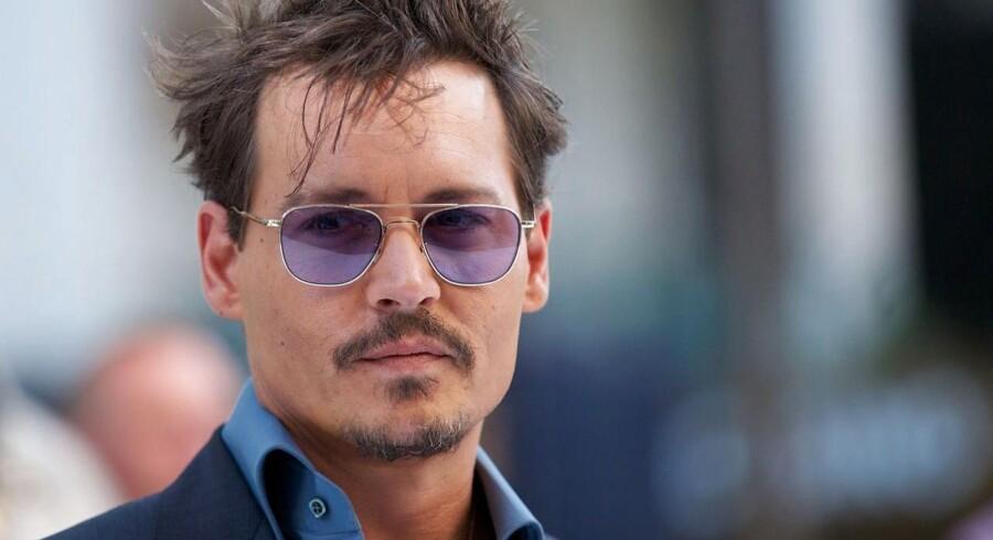 "Johnny Depp ved den engelske premiere på ""The Lone Ranger""."