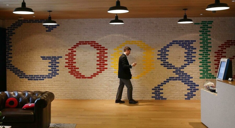 WASHINGTON, DC - JANUARY 08: An employee walks through the lobby of Google's Washington headquarters, January 8, 2015 in Washington, DC. Google held a news conference with Right4Girls and the McCain Insitute to discuss ways to combat and prevent child sex trafficking. Mark Wilson/Getty Images/AFP == FOR NEWSPAPERS, INTERNET, TELCOS & TELEVISION USE ONLY ==