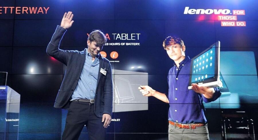 Skuespilleren Ashton Kutcher er hyret til at gøre kinesiske Lenovo til et populært mærke på primært PC-fronten, men nu skal der også satses massivt på mobiltelefoner. Arkivfoto: Joe Klamar, AFP/Scanpix