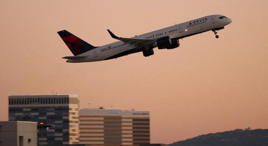 Delta Airlines var et af de luftselskaber, som har hjulpet lufthavnen i Atlanta med at komme op på over 96 millioner passagerer. David McNew/Getty Images/AFP/Scanpix