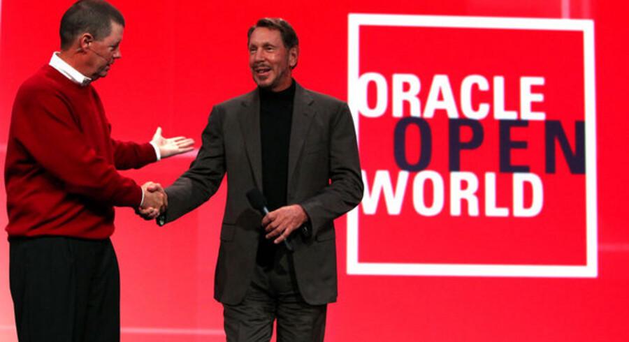 Sun-grundlægger Scott McNealy (til venstre) og Oracle-stifter Larry Ellison (til højre) arbejder allerede tæt sammen, men EU mangler at sige god for det store opkøb, og det koster nu stillinger. Foto: Justin Sullivan, AFP/Scanpix