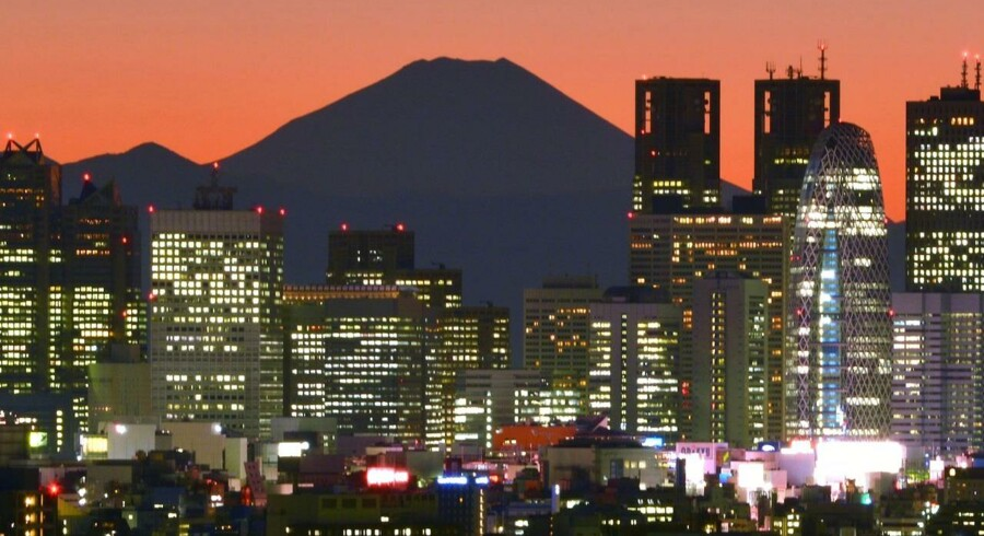 Japan's highest mountain Mount Fuji (C) is seen behind the skyline of the Shinjuku area of Tokyo at sunset. Japan's trade deficit nearly doubled on-year to a bigger-than-expected 10.9 billion USD in October as the country's energy bill soared, government data showed November 20. AFP PHOTO / KAZUHIRO NOGI