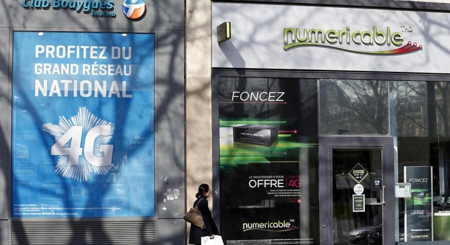 Telekoncerne Bouygues og kabel-TV-selskabet Numericable deltager begge i opløbet om at købe Frankrigs næststørste telekoncern, SFR, og ligesom de to forretninger her ligger deres bud tæt. Foto: Charles Platiau, Reuters/Scanpix