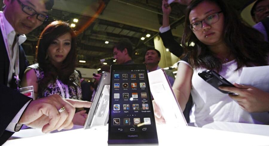 Kinesiske Huawei er verdens tredjestørste mobilproducent efter Samsung og Apple. Nu får Huawei ny topchef hvert halve år. Arkivfoto: Edgar Su, Reuters/Scanpix
